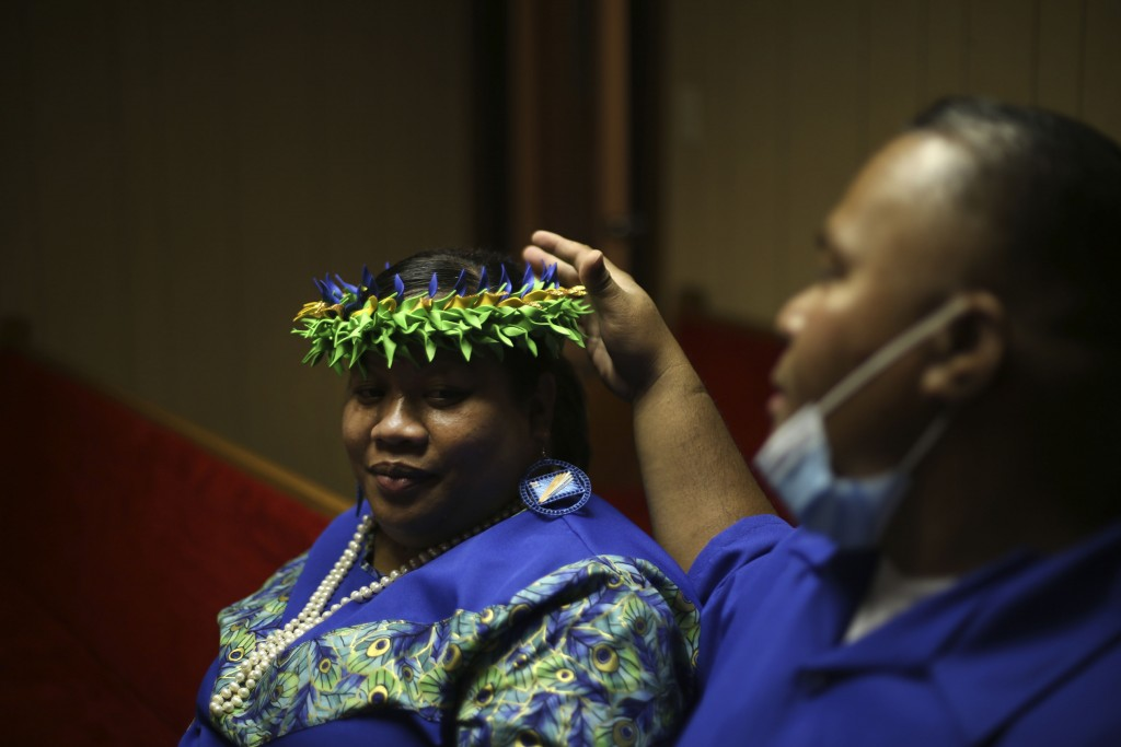 Meritha Jesse smiles at her husband, Pastor Luke Jesse of the First Marshallese Throne in Jouj church, as they sit after services on Sunday, Nov. 22, ...
