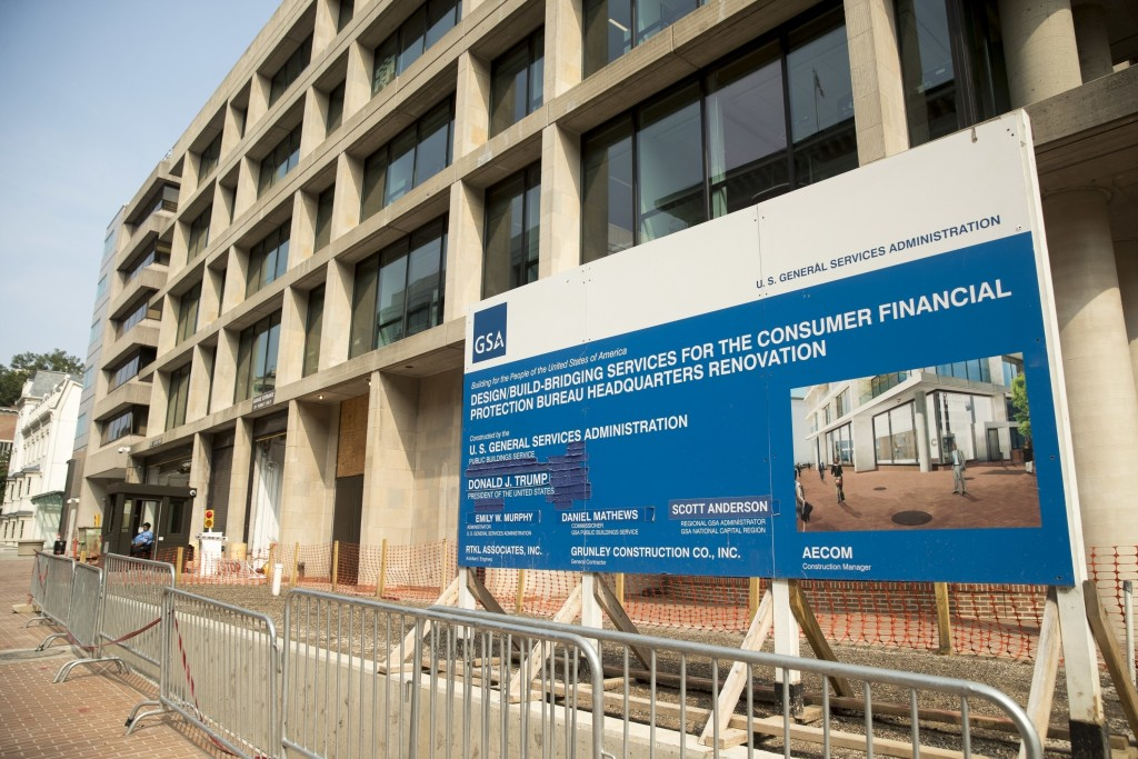 FILE - In this Aug. 27, 2018, file photo, a patched sign stands at the construction site for the Consumer Financial Protection Bureau's new headquarte...
