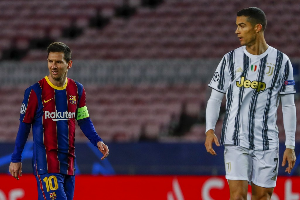 Barcelona's Lionel Messi, left, and Juventus' Cristiano Ronaldo during the Champions League group G soccer match between FC Barcelona and Juventus at ...