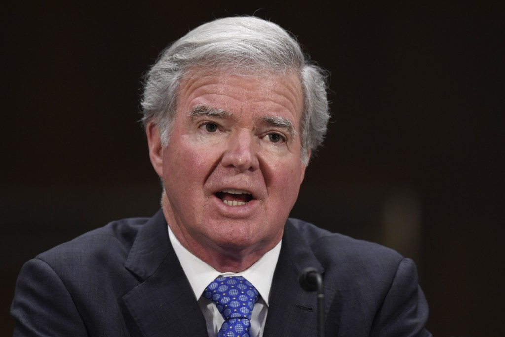 FILE - In this Feb. 11, 2020, file photo, NCAA President Mark Emmert testifies during a Senate Commerce subcommittee hearing on intercollegiate athlet...