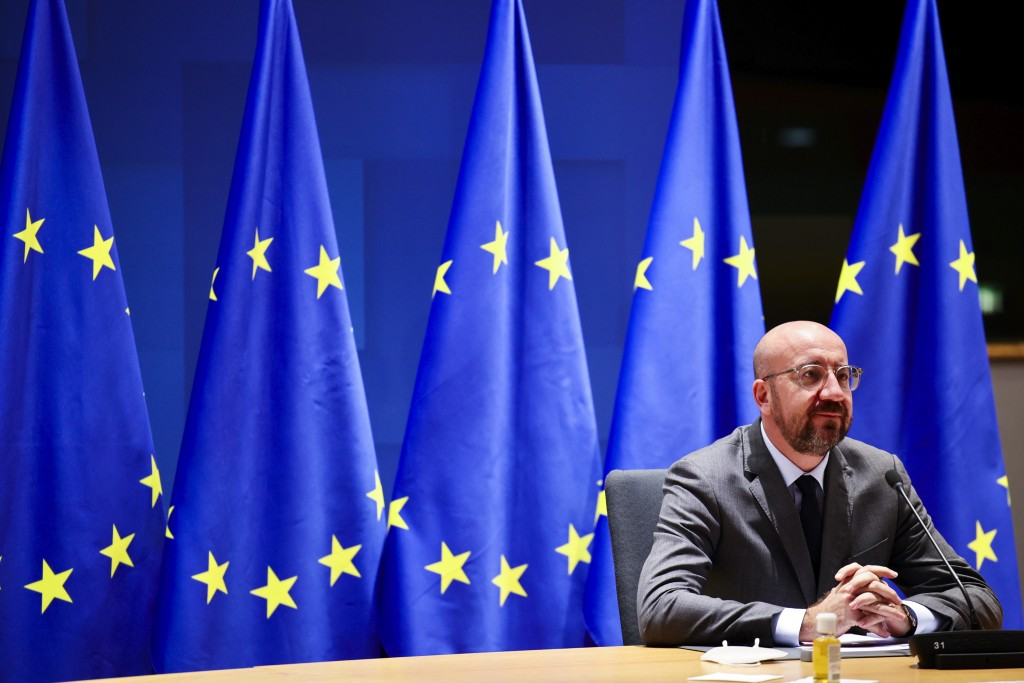 FILE - In this file photo dated Thursday, Nov. 19, 2020, European Council President Charles Michel talks with EU leaders during an EU Summit video con...