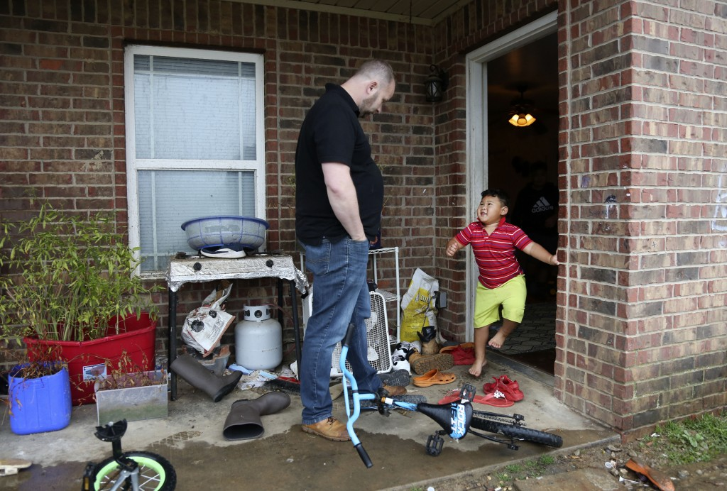 Pastor Joshua Manning, of the Community Baptist Church, visits Gideon and the boy's family after hosting a weekly church food pantry, Saturday, Nov. 2...