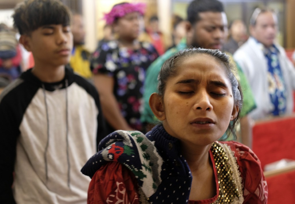 Joann Konou closes her eyes during an evening service at the First Marshallese Throne in Jouj church in Noel, Mo., Sunday, Nov. 22, 2020. (AP Photo/Lu...