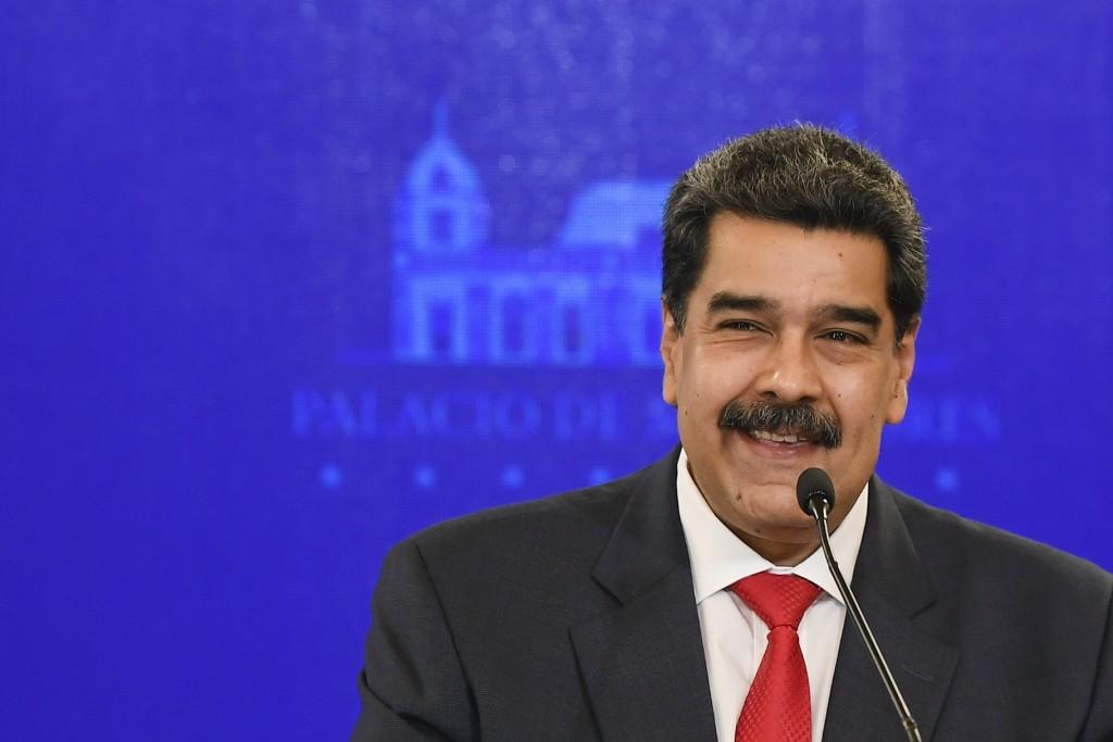 Venezuela's President Nicolas Maduro smiles during a press conference at Miraflores Presidential Palace in Caracas, Venezuela, Tuesday, Dec 8, 2020. M...