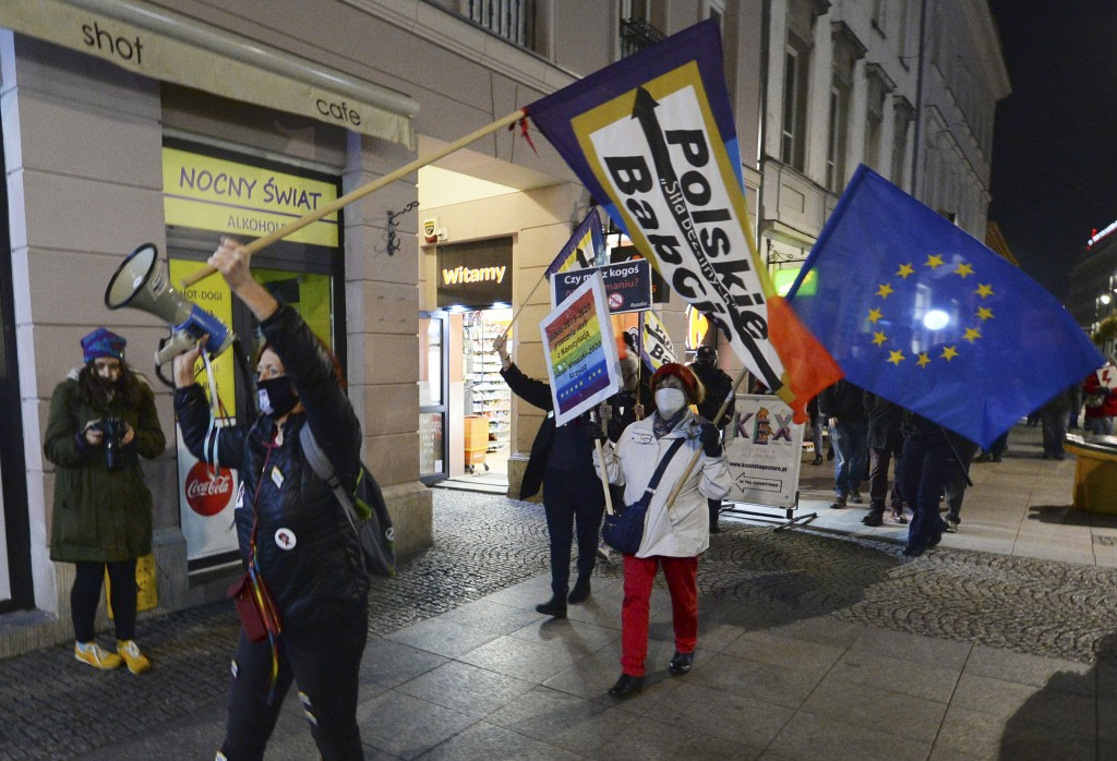 FILE - In this Nov. 5, 2020 file photo, protesters carry an EU flag at an anti-government protest in Warsaw, Poland. Some Poles are afraid that a draw...