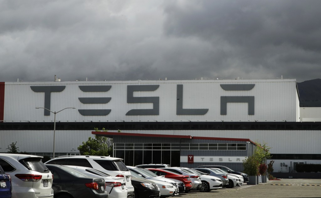 FILE - This May 12, 2020 file photo photo shows the Tesla plant in Fremont, Calif. Tesla is looking to raise up to $5 billion in capital through a sto...
