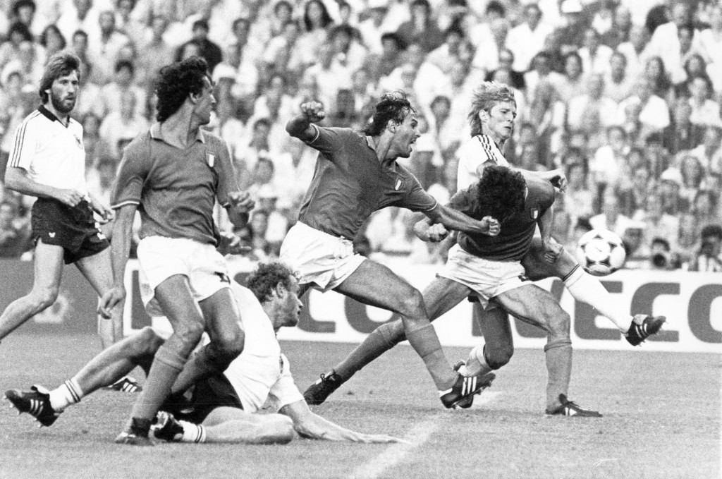 FILE - Paolo Rossi, right, puts his head down to hit the ball from a ruck of players, to score Italy's first goal, in the World Cup soccer final at Ma...