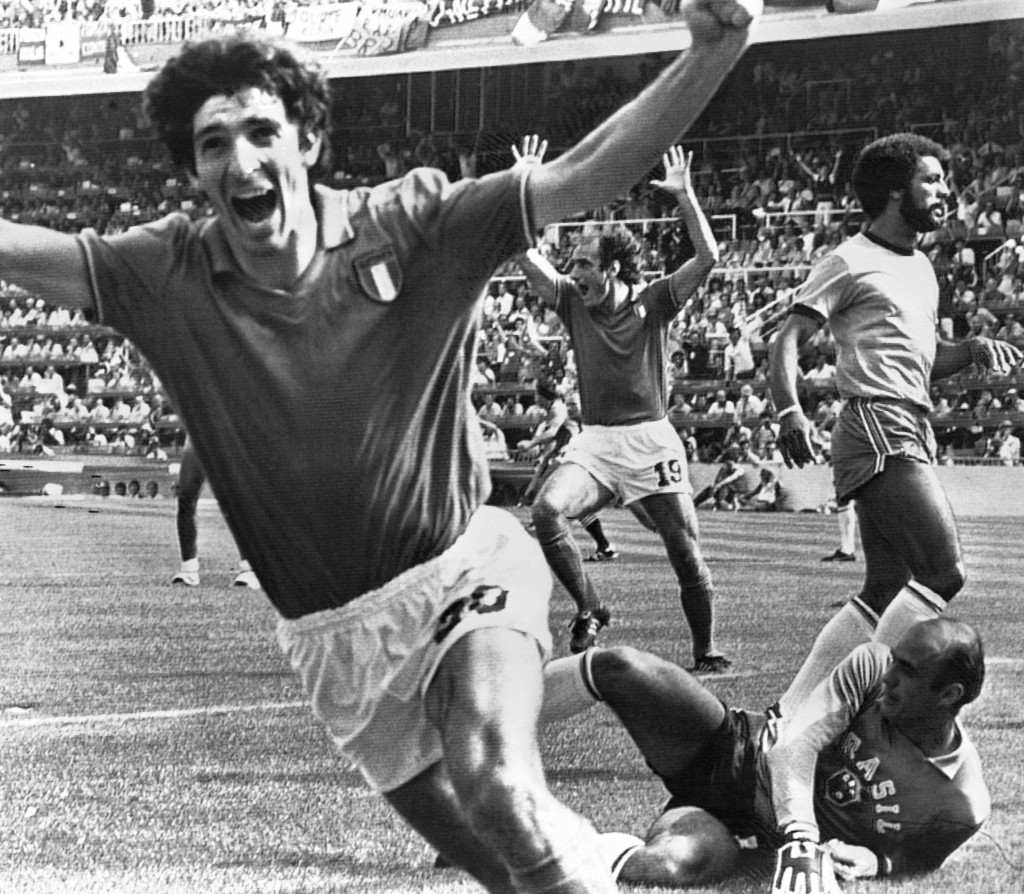 FILE - In this July 5, 1982 file photo, Italy's Paolo Rossi, left, celebrates, after scoring the second goal for his team during their World Cup secon...