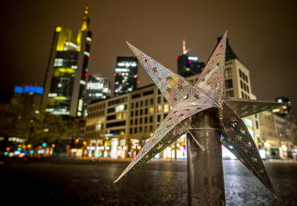 A paper star decoration sits on a pole in central Frankfurt, Germany, Thursday, Dec. 10, 2020. (AP Photo/Michael Probst,Pool)