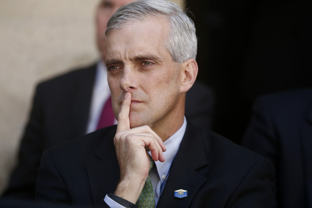 FILE - In this Oct. 28, 2013, file photo, White House Chief of Staff Denis McDonough listens as President Barack Obama speaks at FBI Headquarters in W...