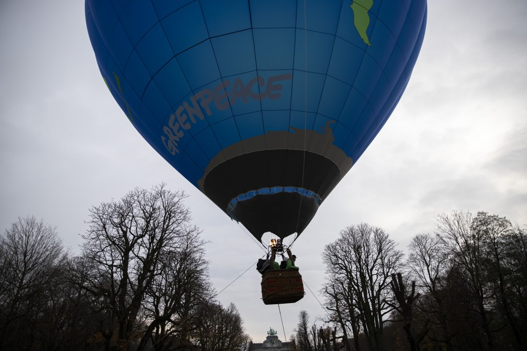 Environmental activists launch a hot air balloon during a demonstration outside of an EU summit in Brussels, Thursday, Dec. 10, 2020. European Union l...