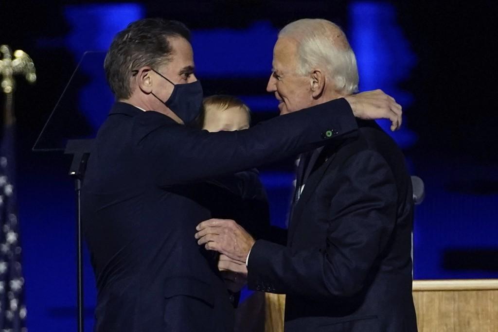 FILE - In this Nov. 7, 2020, file photo, President-elect Joe Biden, right, embraces his son Hunter Biden, left, in Wilmington, Del. Biden's son Hunter...