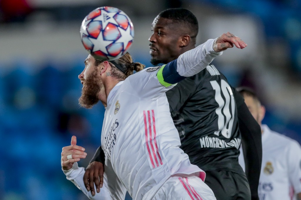 Real Madrid's Sergio Ramos, left, heads for the ball with Moenchengladbach's Marcus Thuram during the Champions League group B soccer match between Re...