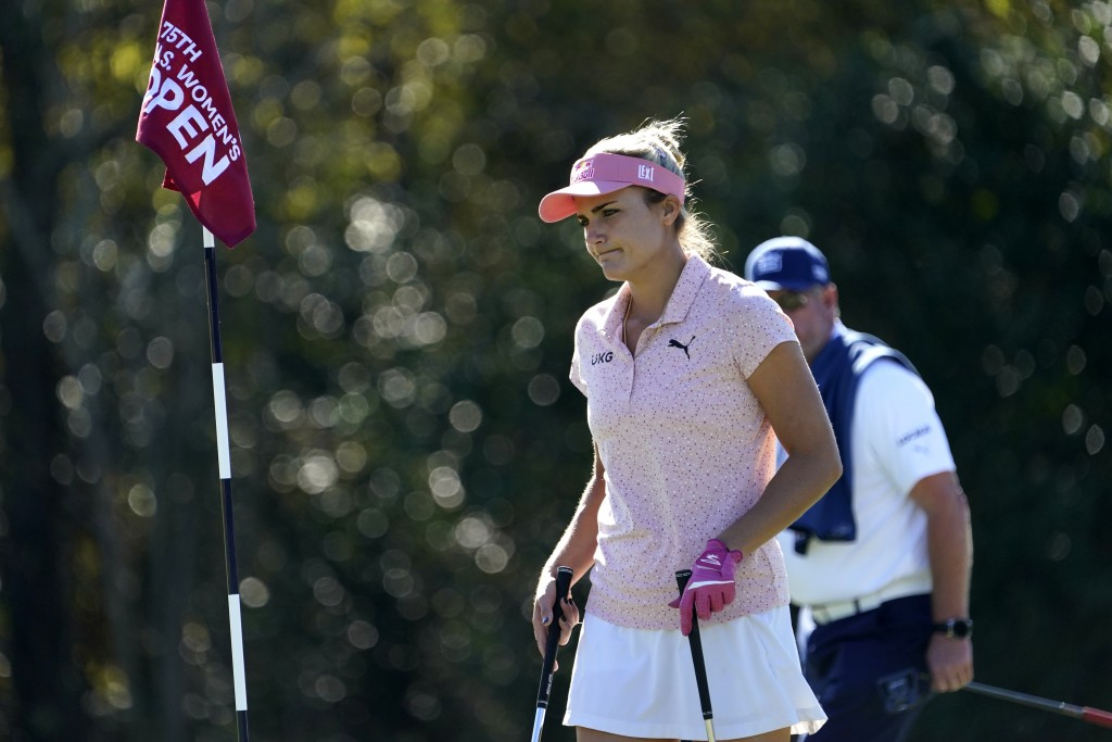 Lexi Thompson walks on the 11th green during a practice round at the U.S. Women's Open golf championship Wednesday, Dec. 9, 2020, in Houston.(AP Photo...
