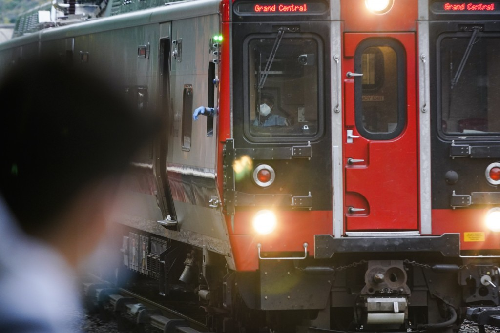 A train operator wears Personal protective equipment while passing patrons at the Fordham Metro North station Thursday, Oct. 22, 2020, in New York.  (...