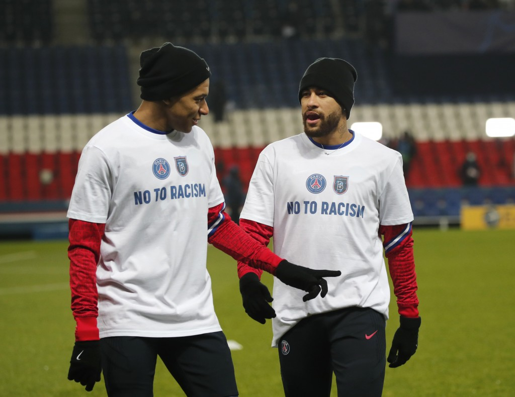 PSG's Kylian Mbappe, left, and PSG's Neymar warm up before the Champions League group H soccer match between Paris Saint Germain and Istanbul Basakseh...