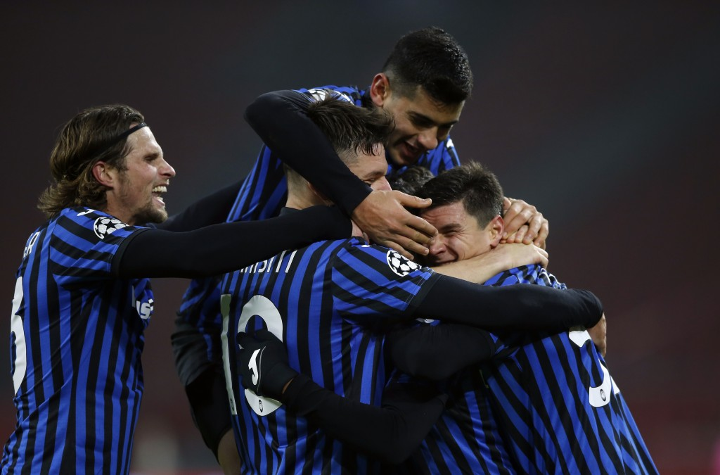 Atalanta's Luis Muriel celebrates with teammates after scoring his side's opening goal during the group D Champions League soccer match between Ajax a...