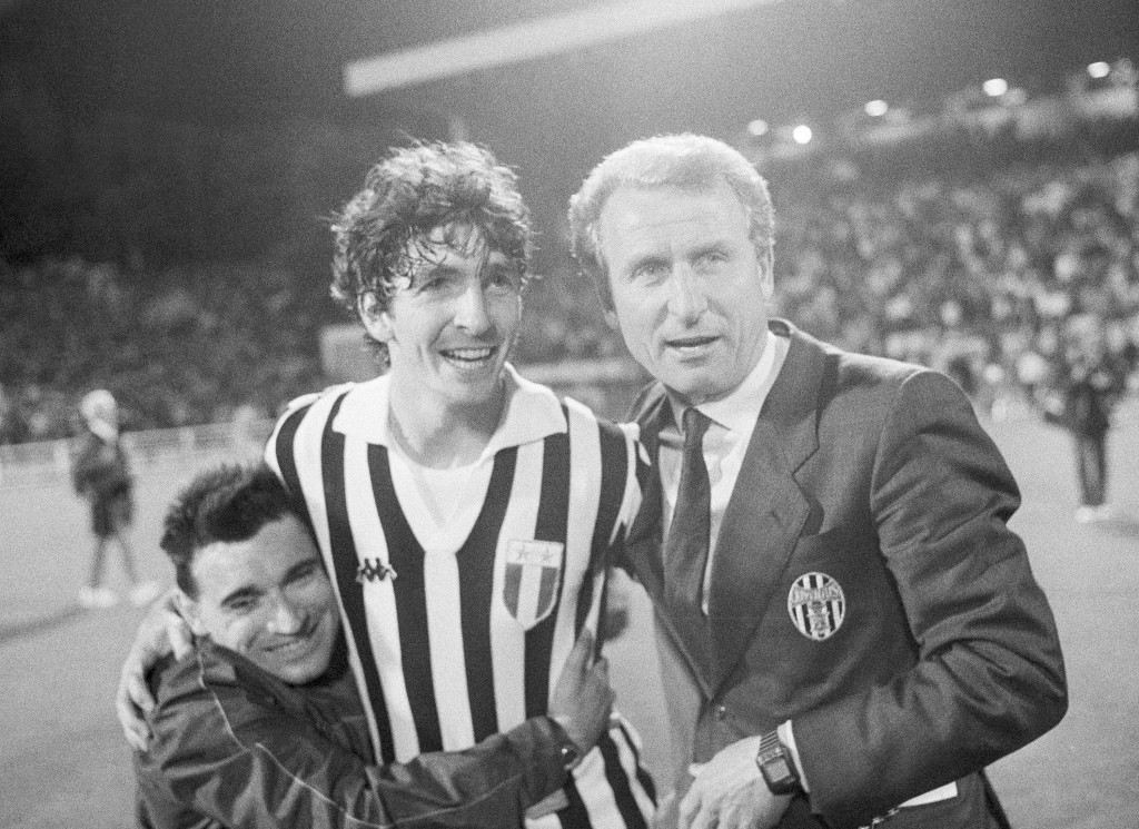 FILE - In this May 30, 1985 file photo, Juventus Turin soccer player Paolo Rossi is embraced by a fan as he stands with Juventus team manager Giovanni...