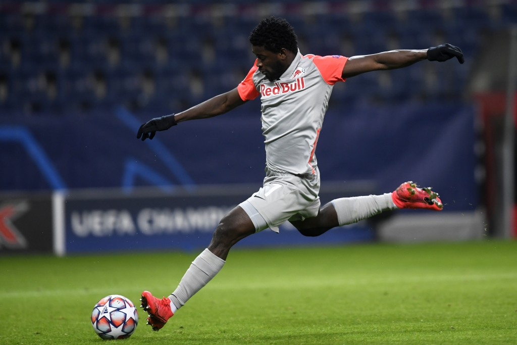 Salzburg's Sekou Koita attempts a shot at goal during the Champions League group A soccer match between RB Salzburg and Atletico Madrid in Salzburg, A...