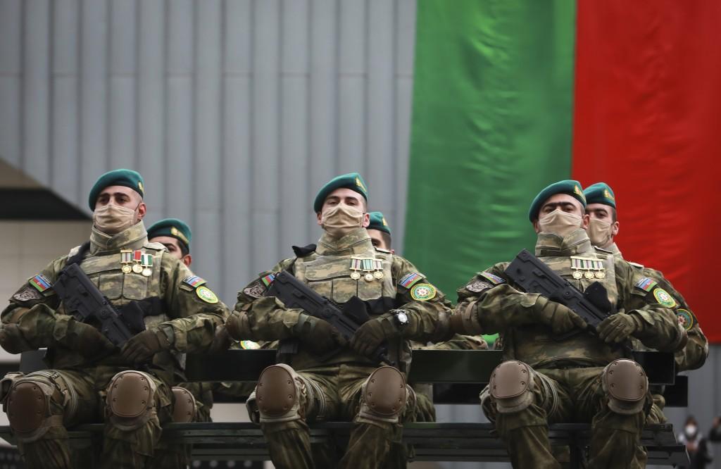 Azerbaijani troops attend the parade in Baku, Azerbaijan, Thursday, Dec. 10, 2020. A military parade has been held in the Azerbaijani capital in celeb...
