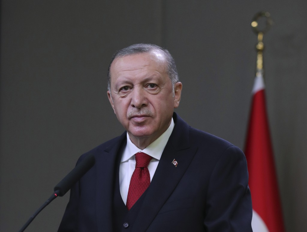 Turkey's President Recep Tayyip Erdogan speaks to reporters before departing for a visit to Azerbaijan, in Ankara, Turkey, Wednesday, Dec. 9, 2020. Er...
