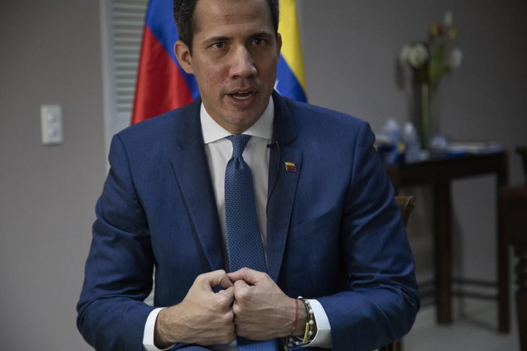 Venezuelan opposition leader Juan Guaidó speaks during an interview with The Associated Press, in Caracas, Venezuela, Wednesday, Dec. 9, 2020. Guaidó ...