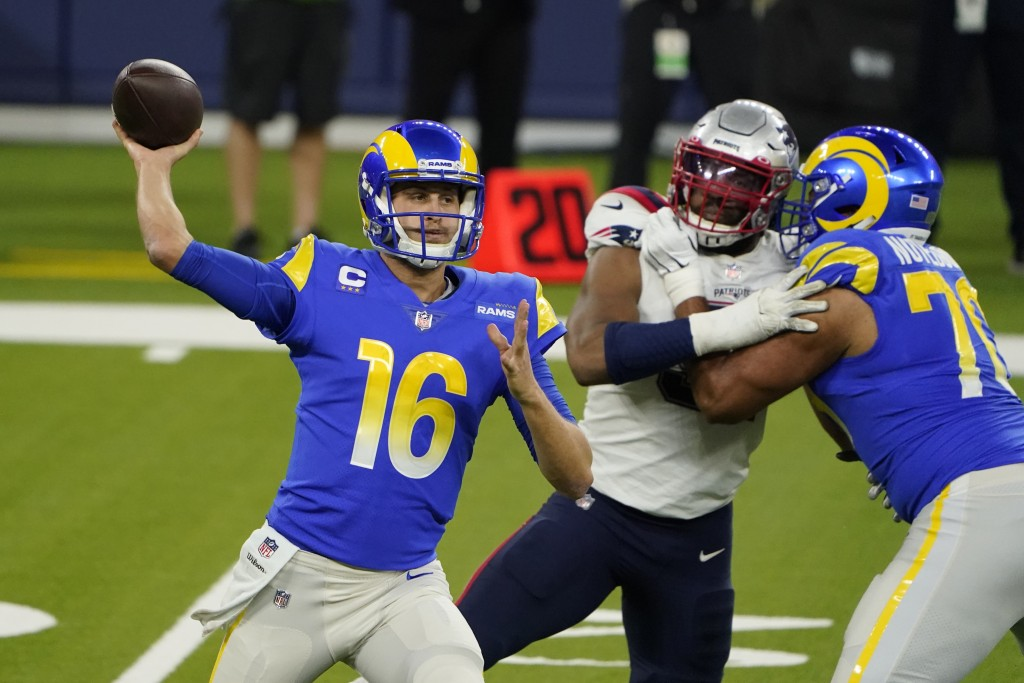 Los Angeles Rams quarterback Jared Goff (16) throws against the New England Patriots during the first half of an NFL football game Thursday, Dec. 10, ...