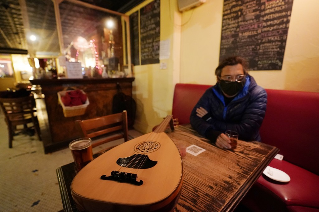 Customer Koray Calistan, has a drink at Barbès, a popular neighborhood music venue and bar converted to a bottle shop to survive the winter during the...