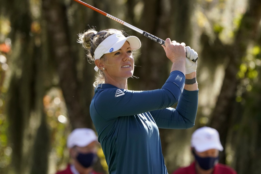 Amy Olson watches her shot off the third tee during the first round of the U.S. Women's Open golf tournament in Houston, Thursday, Dec. 10, 2020. (AP ...