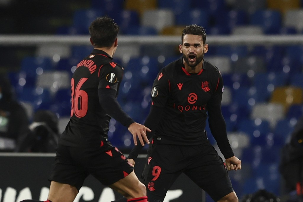 Real Sociedad's William Jose, right, celebrates after scoring during the Europa League, group F soccer match between Napoli and Real Sociedad, at the ...