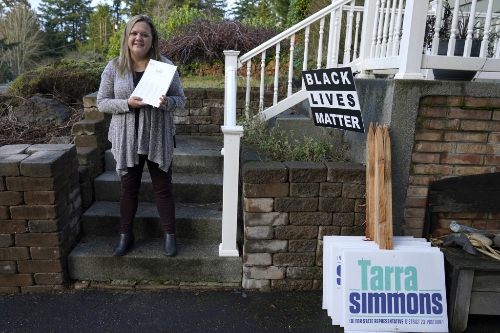Rep. Tarra Simmons, D-Bremerton, holds blank voter registration forms as she poses for a photo, Wednesday, Dec. 9, 2020, at her home in Bremerton, Was...