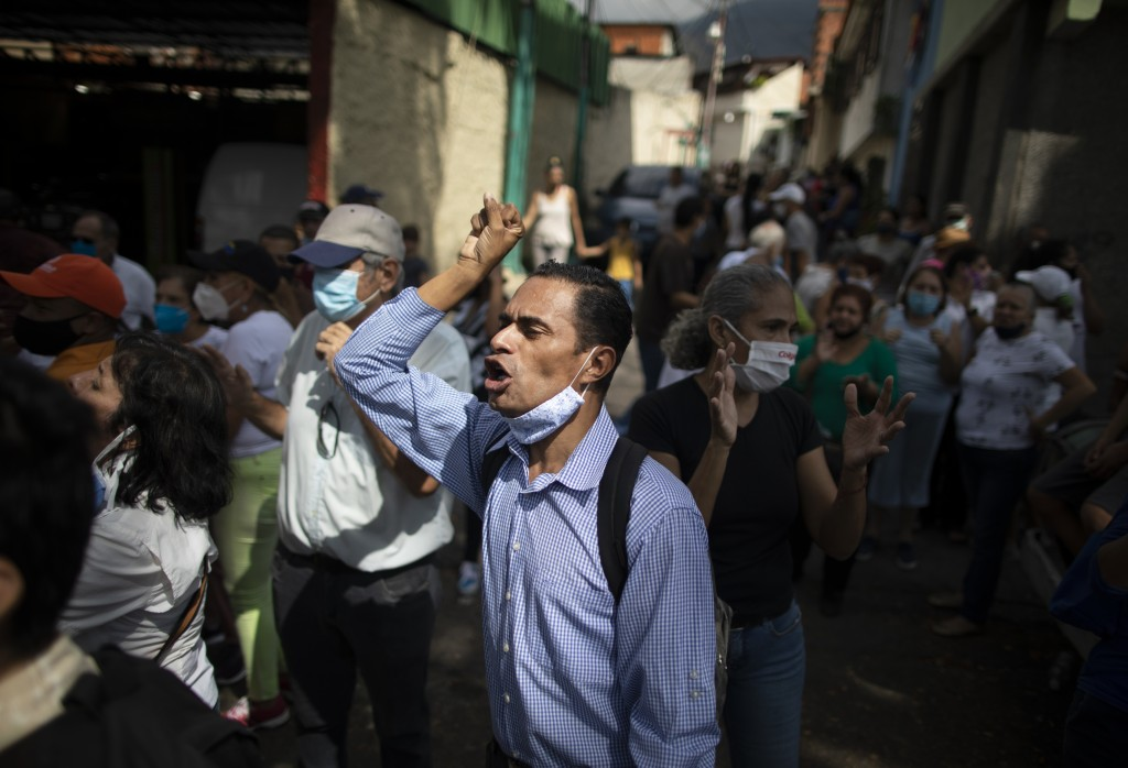 """A supporter chants """"consulta popular"""" or """"national consultation"""", during a visit by opposition leader Juan Guaidó to La Lucha neighborhood of Caracas,..."""