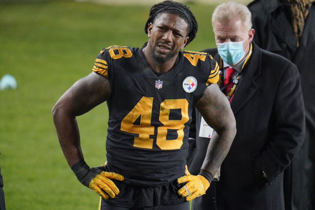 Pittsburgh Steelers outside linebacker Bud Dupree grimaces as walks on the sideline after being injured playing against the Baltimore Ravens during an...