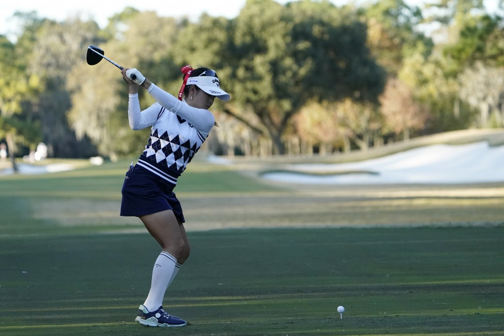 Yui Kawamoto of Japan, hits from the ninth tee, during the first round of the U.S. Women's Open Golf tournament, Thursday, Dec. 10, 2020, in Houston. ...