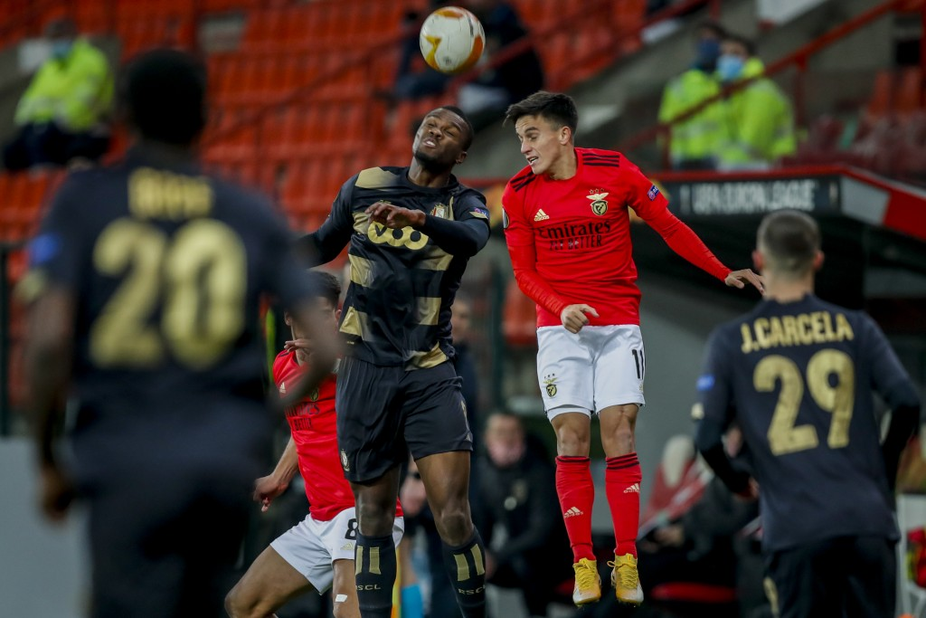 Benfica's Franco Cervi, right, heads for the ball with Liege's Gojko Cimirot during the Europa League group D soccer match between Standard Liege and ...