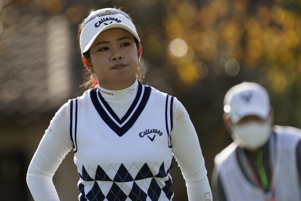 Yui Kawamoto of Japan, reacts to her putt on the fourth green, during the first round of the U.S. Women's Open Golf tournament, Thursday, Dec. 10, 202...