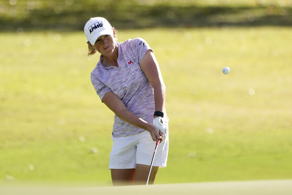 Stacy Lewis chips onto the third green during the first round of the U.S. Women's Open golf tournament in Houston, Thursday, Dec. 10, 2020. (AP Photo/...