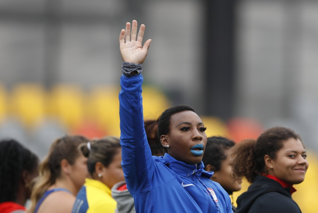 FILE - In this Aug. 10, 2019, file photo, Gwen Berry of the United States waves as she is introduced at the start of the women's hammer throw final du...