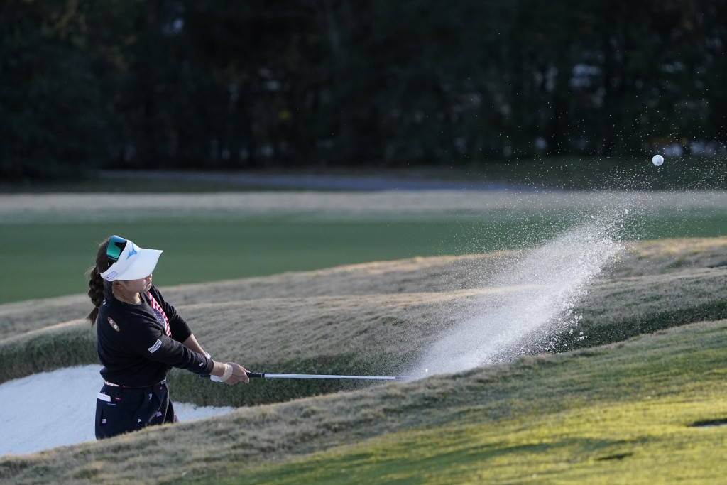 Saki Asai, of Japan, hits out of the bunker on the ninth hole, during the first round of the U.S. Women's Open Golf tournament, Thursday, Dec. 10, 202...
