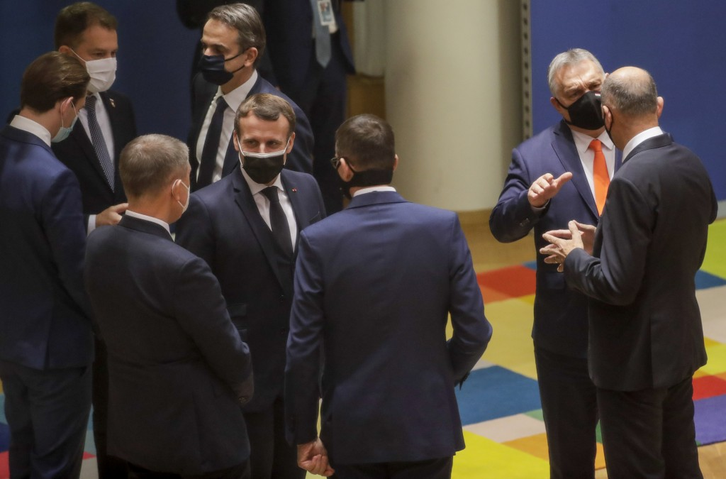 French President Emmanuel Macron, center, speaks with Czech Republic's Prime Minister Andrej Babis, third left, and Poland's Prime Minister Mateusz Mo...