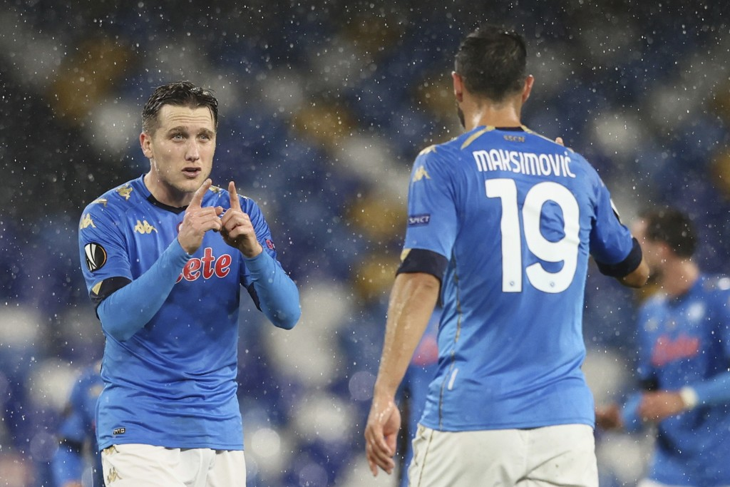 Napoli's Piotr Zielinski, left, celebrates after scoring during the Europa League, group F soccer match between Napoli and Real Sociedad, at the Diego...