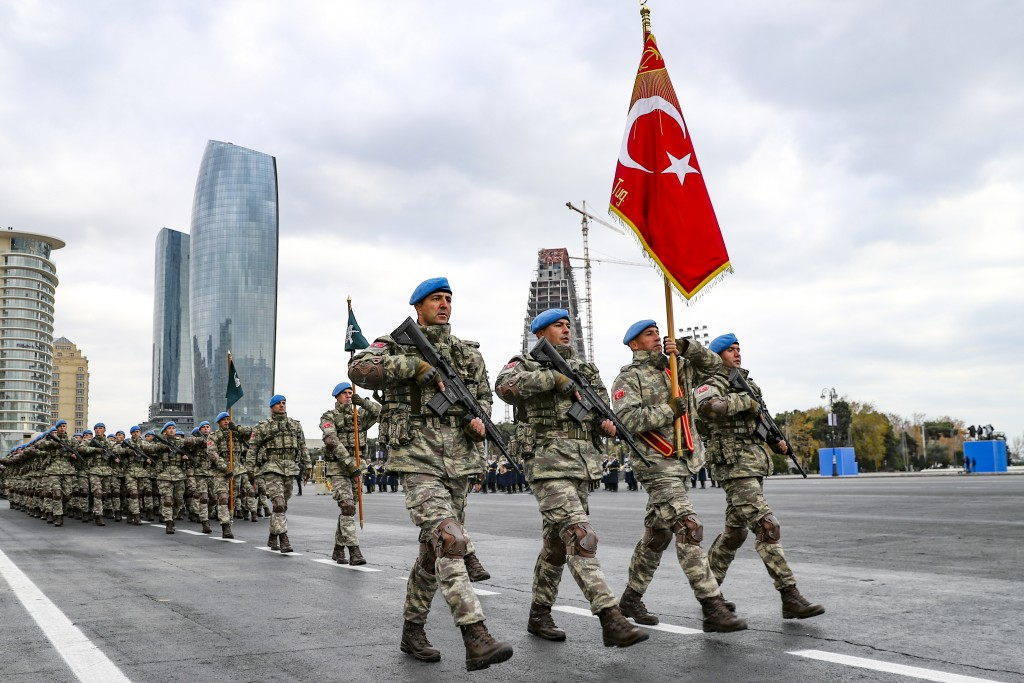 Members of a Turkish forces commando brigade take part in a military parade in which Turkey's President Recep Tayyip Erdogan and Azerbaijan's Presiden...