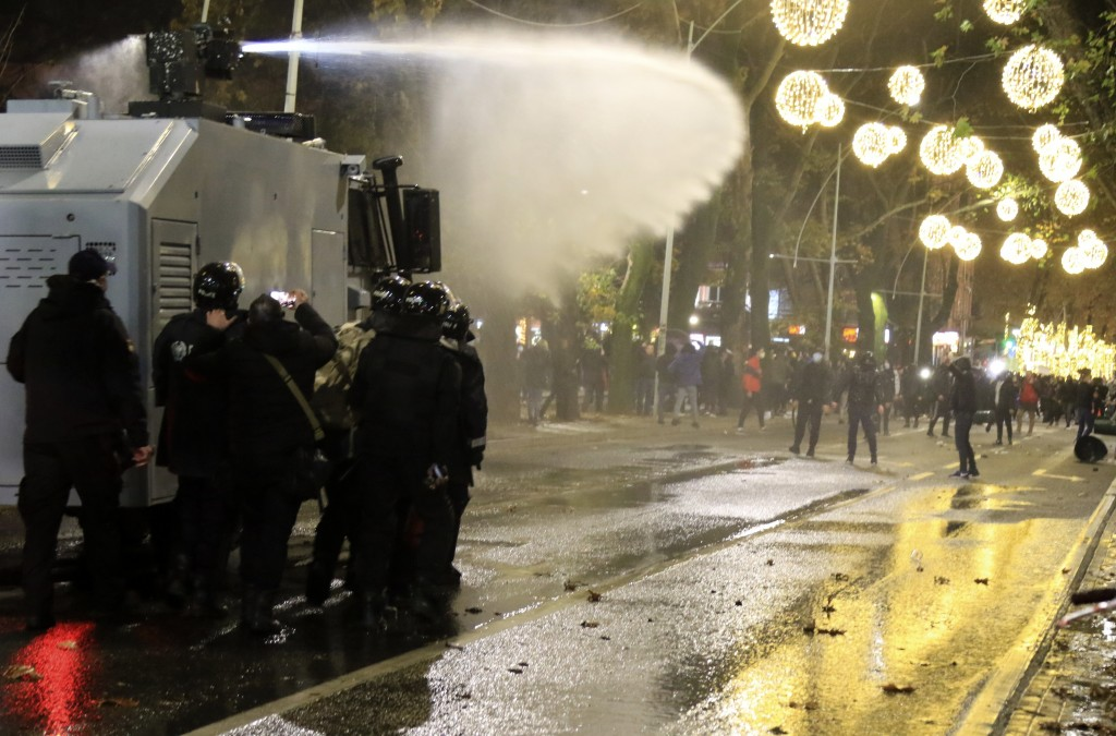 Albanian police use a water cannon against protesters during clashes in Tirana, Thursday, Dec. 10, 2020. Albanian protesters on Thursday renewed clash...