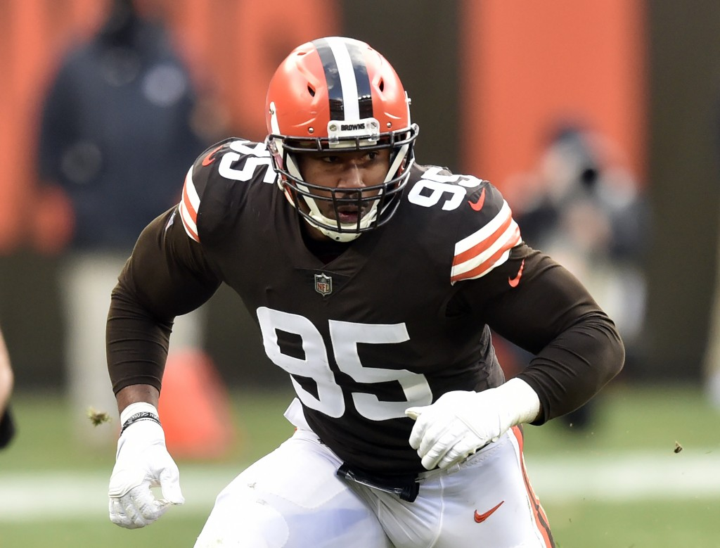 FILE - In this Nov. 15, 2020, file photo, Cleveland Browns defensive end Myles Garrett rushes the passer during an NFL football game against the Houst...
