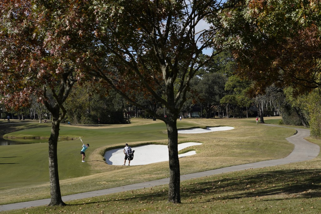 Austin Ernst hits from the 12th fairway, during the first round of the U.S. Women's Open Golf tournament, Thursday, Dec. 10, 2020, in Houston. (AP Pho...