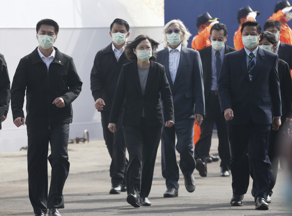 Taiwan's President Tsai Ing-wen walks during a delivery and launching ceremony of domestically built warships at the Jong Shyn Shipbuilding Corp's shi...