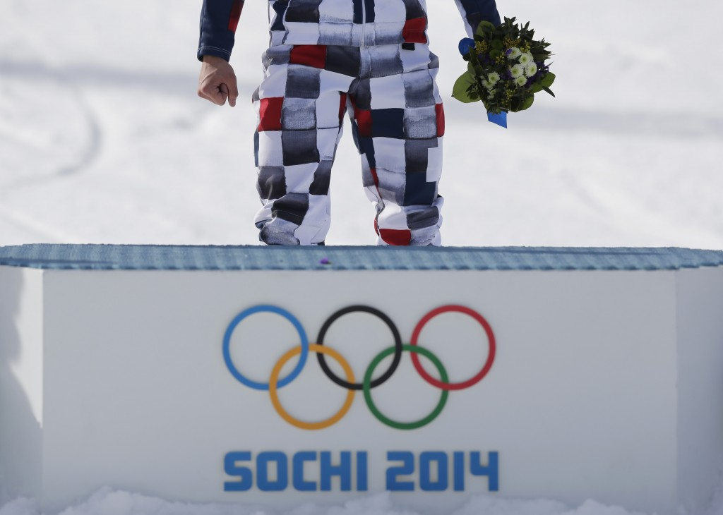 FILE - In this Feb. 19, 2014, file photo, a gold medalist stands behind the podium after the flower ceremony at the Rosa Khutor Extreme Park, at the 2...
