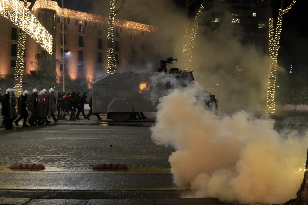 Albanian police operates during clashes in Tirana, Friday, Dec. 11, 2020. Albanian demonstrators clashed in the third day on Friday protesting for the...