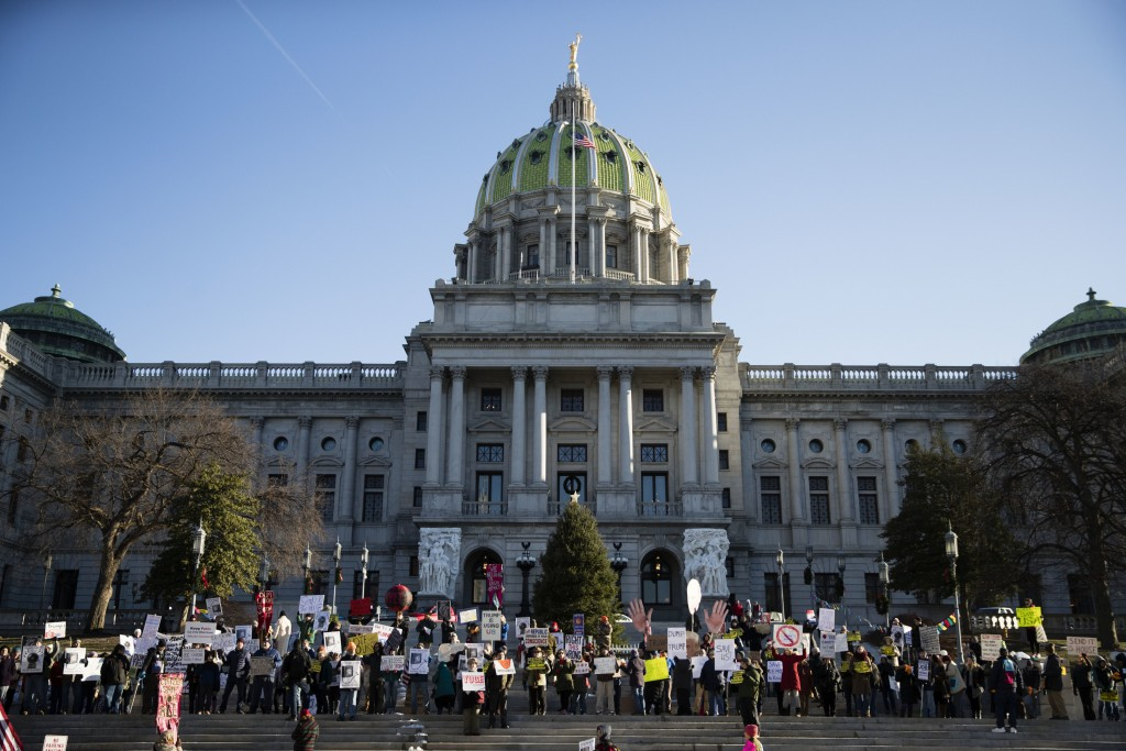 FILE—In this file photo from Dec. 19, 2016, protesters demonstrated ahead of Pennsylvania's 58th Electoral College at the state Capitol in Harrisburg,...
