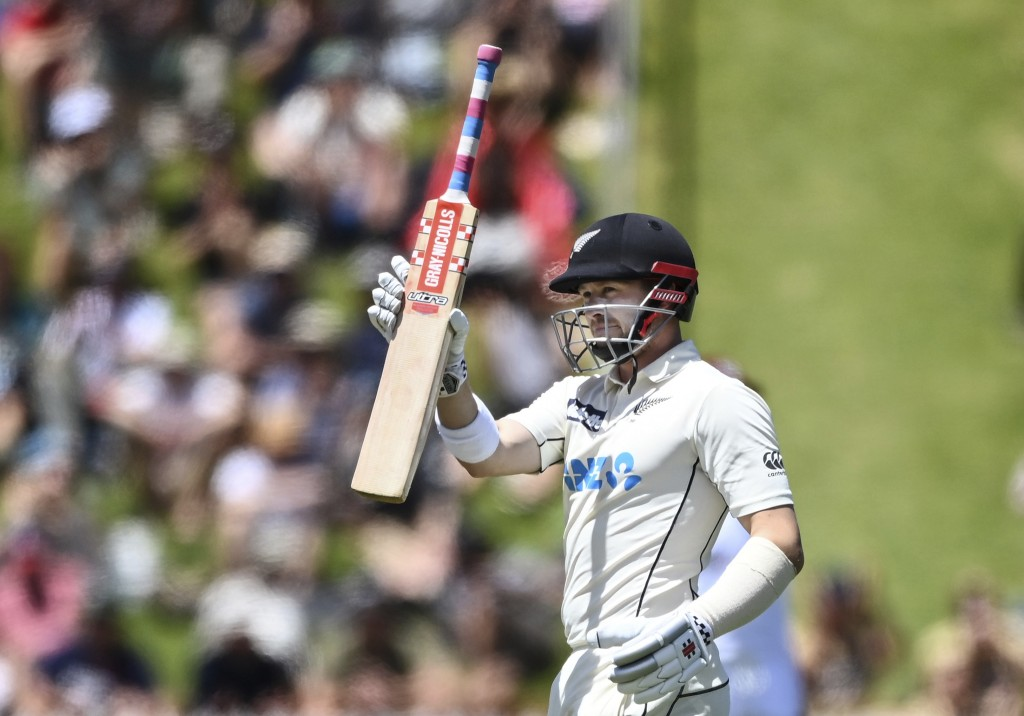New Zealand's Henry Nicholls raises his bat after reaching 150 runs against the West Indies during play on the second day of their second cricket test...